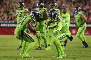 GLENDALE, AZ - NOVEMBER 09:  Strong safety Kam Chancellor #31 and defensive back Bradley McDougald #30 of the Seattle Seahawks celebrate a turnover on downs against the Arizona Cardinals at University of Phoenix Stadium on November 9, 2017 in Glendale, Arizona. The Seattle Seahawks won 22-16.  (Photo by Christian Petersen/Getty Images)
