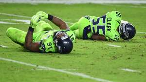GLENDALE, AZ - NOVEMBER 09: Defensive end Frank Clark #55 and defensive tackle Sheldon Richardson #91 of the Seattle Seahawks both lay on the field after a play in the second half of the NFL game against the Arizona Cardinals at University of Phoenix Stadium on November 9, 2017 in Glendale, Arizona. The Seattle Seahawks won 22-16. (Photo by Norm Hall/Getty Images)