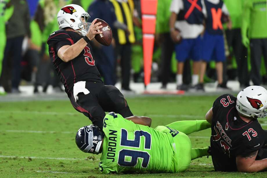 GLENDALE, AZ - NOVEMBER 09:  Quarterback Drew Stanton #5 of the Arizona Cardinals is sacked by defensive end Dion Jordan #95 of the Seattle Seahawks in the second half at University of Phoenix Stadium on November 9, 2017 in Glendale, Arizona. The Seattle Seahawks won 22-16.  (Photo by Norm Hall/Getty Images) Photo: Norm Hall/Getty Images