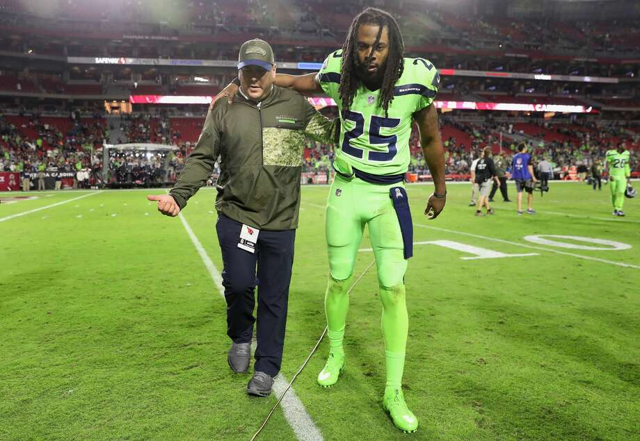 GLENDALE, AZ - NOVEMBER 09:  Cornerback Richard Sherman #25 of the Seattle Seahawks is helped off the field following the NFL game against the Arizona Cardinals at the University of Phoenix Stadium on November 9, 2017 in Glendale, Arizona.  The Seahawks defeated the Cardinals 22-16.  (Photo by Christian Petersen/Getty Images) Photo: Christian Petersen/Getty Images