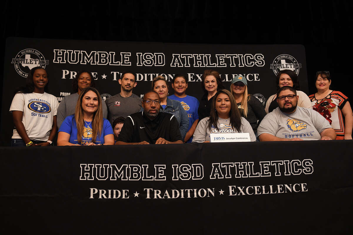 Josalyn Contreras, front row center, who plays softball for Humble High School, signs with Jarvis Christian College during the Humble ISD Signing Day Ceremony at Charles Bender Performing Arts Center in Humble on Nov. 8, 2017. (Photo by Jerry Baker/Freelance)
