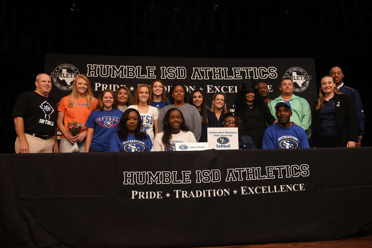 Felicia Drake, front row center, who plays softball for Humble High School, signs with Southeastern Oklahoma State University during the Humble ISD Signing Day Ceremony at Charles Bender Performing Arts Center in Humble on Nov. 8, 2017. (Photo by Jerry Baker/Freelance)