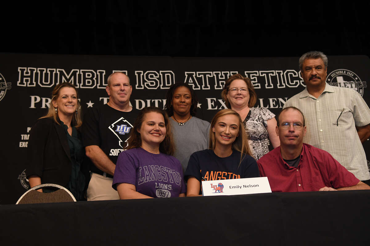 Emily Nelson, front row center, who plays softball for Humble High School, signs with Langston University during the Humble ISD Signing Day Ceremony at Charles Bender Performing Arts Center in Humble on Nov. 8, 2017. (Photo by Jerry Baker/Freelance)