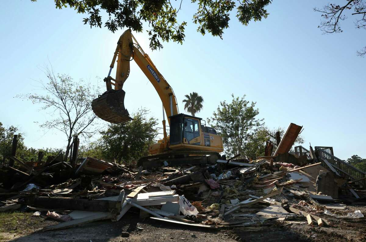 A home that was bought out by Harris County on the 2600 block of Shorewick Drive was the first to be demolished after being flooded during Harvey Friday, Nov. 10, 2017, in Highlands, Texas.