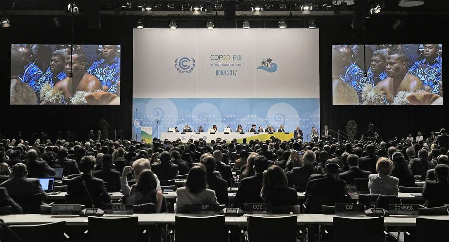 Native people from Fiji sit in the convention center at the opening of the U.N. Climate Change conference in Bonn, Germany. Photo: Martin Meissner, Associated Press