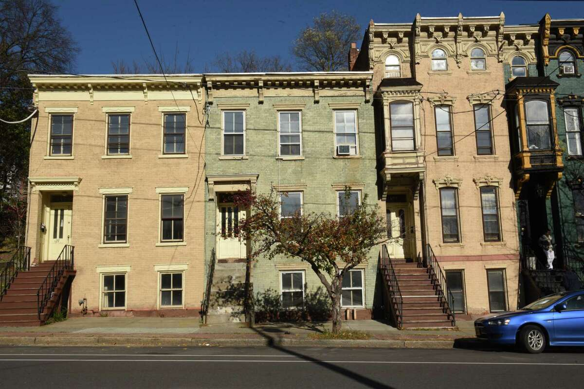 Buildings at 127, left, 125, center, and 119 Clinton Ave. on Friday, Nov. 10, 2017 in Albany, N.Y. A Rochester-based developer planning to rehabilitate roughly 70 buildings in Arbor Hill wants an $8 million reduction in taxes over 30 years to help the $47 million affordable housing project come to fruition on Clinton Avenue and Ten Broeck St. (Lori Van Buren / Times Union)`