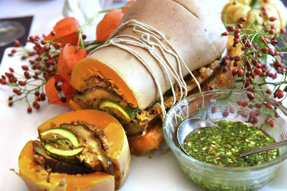 "Vegan ""turducken"" prepared by Deanna Fox at her home on Thursday, Oct. 12, 2017 in Delanson, N.Y. This vegan option for Thanksgiving is made with lentils, mushrooms, butternut squash, eggplant and zucchini and topped with pecans and fresh herb gravy. (Lori Van Buren / Times Union) Photo: Lori Van Buren / 20041806A"