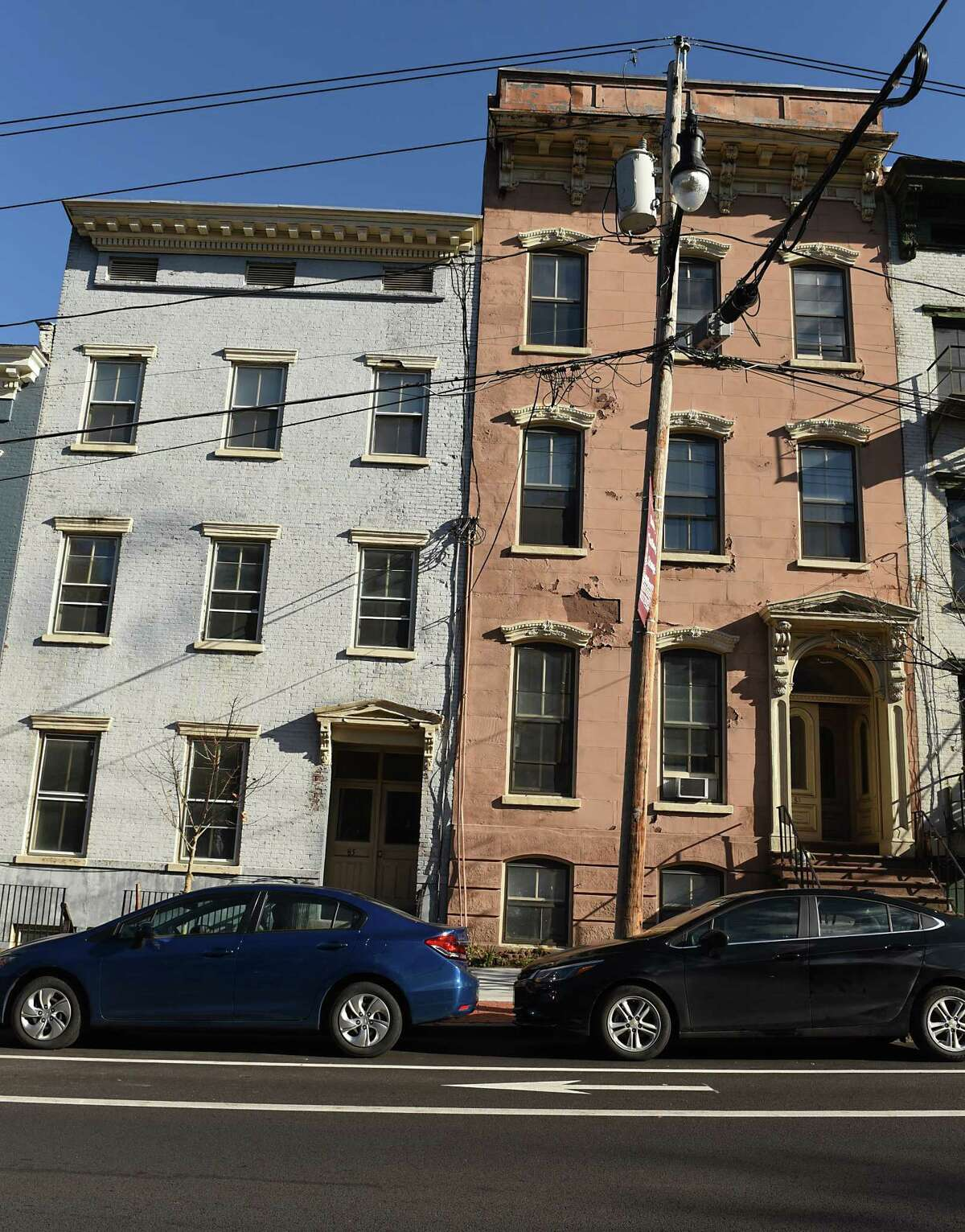 Buildings at 85, left, and 83 Ten Broeck St. on Friday, Nov. 10, 2017 in Albany, N.Y. A Rochester-based developer planning to rehabilitate roughly 70 buildings in Arbor Hill wants an $8 million reduction in taxes over 30 years to help the $47 million affordable housing project come to fruition on Clinton Avenue and Ten Broeck St. (Lori Van Buren / Times Union)`