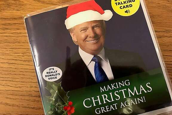 Donald Trump as a greeting card talking Santa