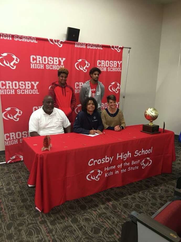Crosby girls basketball player Sloan Casey (center) signs her scholarship letter to play basketball for Texas A&M-Commerce Photo: Crosby ISD Facebook Page
