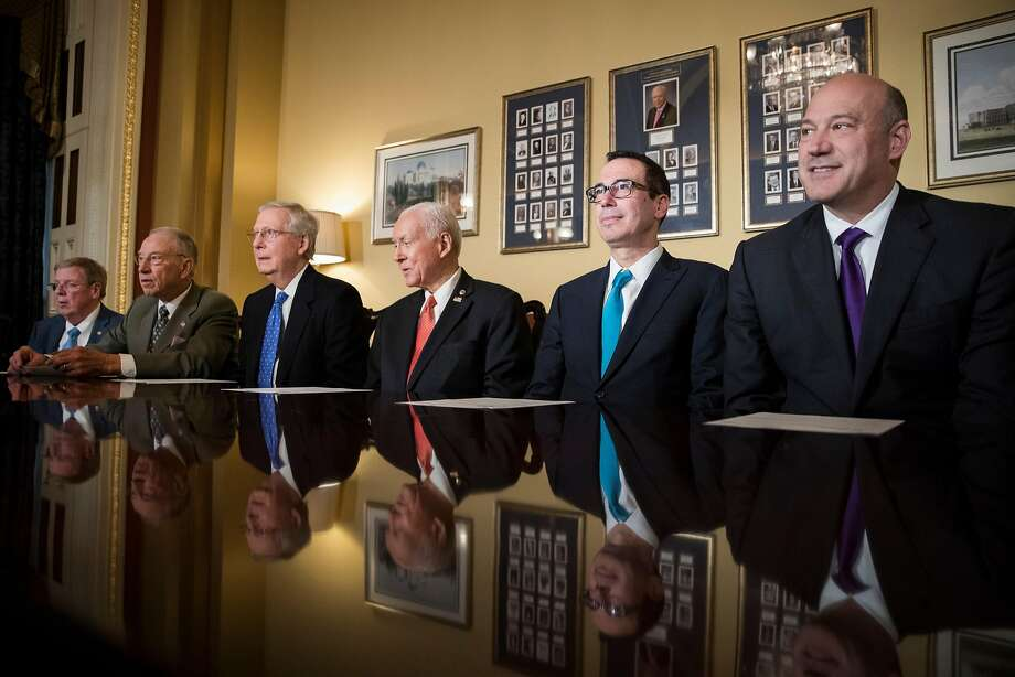 Republican U.S. Sens. Johnny Isakson, Ga., (left), Charles Grassley, Iowa, Mitch McConnell, Ky., Orrin Hatch, Utah, and Treasury Secretary Steven Mnuchin and chief White House economic adviser Gary Cohn meet on tax reform. Photo: TOM BRENNER, NYT