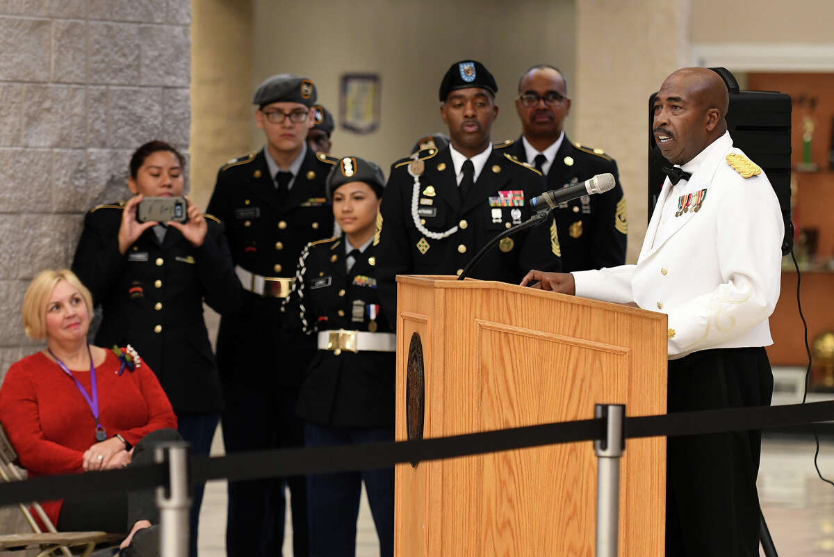 Guest speaker Major (retired) Edward C. Johnson, right, makes his remarks during the Humble High School Wildcat Salute to Veterans in the HHS Commons on Nov. 10, 2017. (Photo by Jerry Baker/Freelance)
