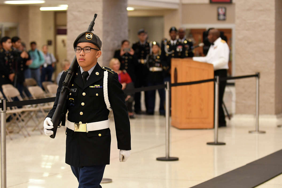 Cadet Sgt. Jericho Gonzaga, 15, a Humble High School sophomore and member of the HHS Army JROTC, guards the Tomb of the Unknown Soldier replica during the HHS Wildcat Salute to Veterans in the HHS Commons on Nov. 10, 2017. (Photo by Jerry Baker/Freelance)