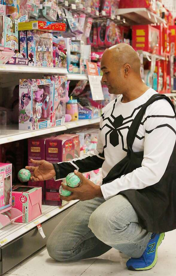 Anwar Ansari of Singapore gets some LOL Surprise Lil Sisters at City Target at S.F.'s Metreon. The Lil Sisters, dolls packed with a handful of accessories, are easier to find than the red-hot LOL Big Surprise. Photo: Lea Suzuki, The Chronicle