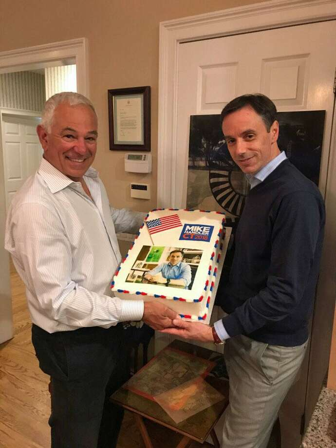 Stamford resident Bobby Valentine and New Canaan's Mike Handler pose with a special cake from Forever Sweet Bakery at a fundraiser in Handler's honor at Valentine's home. Photo: Contributed Poto