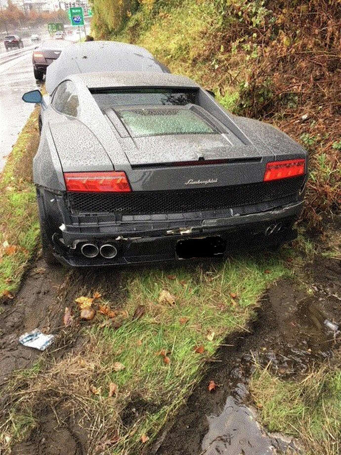 A Bellevue driver bashed a rented Lamborghini into a guard rail after losing control on slick roads. Photo: Washington State Patrol