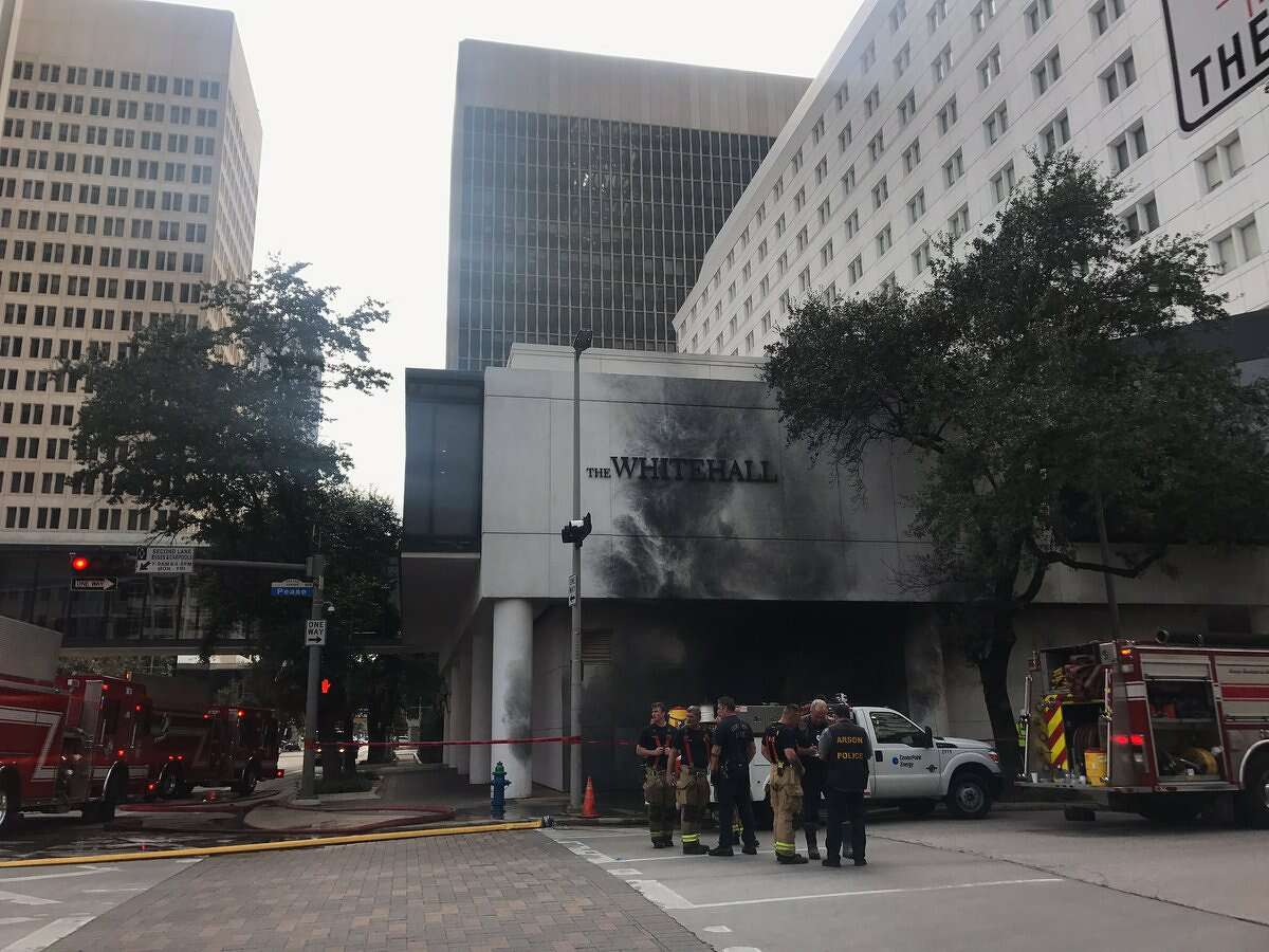 Houston firefighters clean up the scene of an explosion at The Whitehall Hotel on Friday, Nov. 19, 2017, in Houston. ( Marialuisa Rincon / Houston Chronicle)