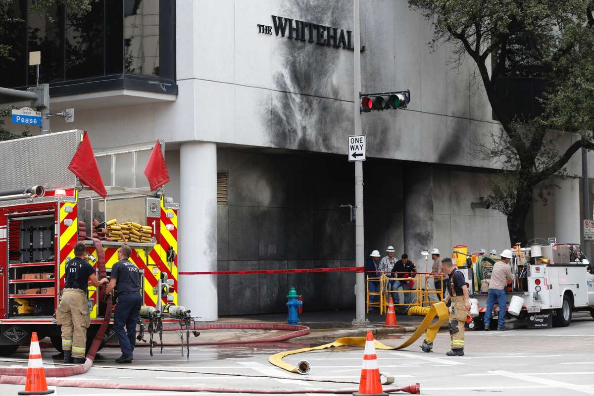 Houston firefighters clean up the scene of an explosion at The Whitehall Hotel on Friday, Nov. 19, 2017, in Houston. ( Brett Coomer / Houston Chronicle)