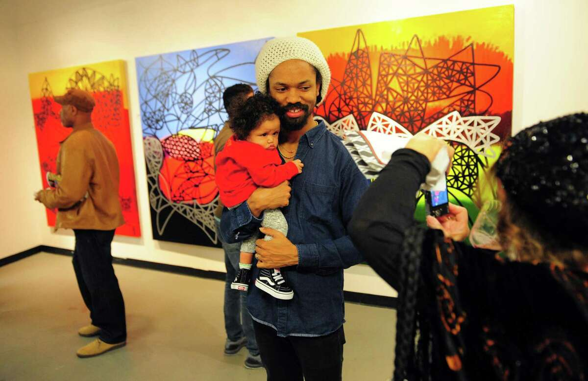 Ras Omari and his daughter Kaya Bodhi, 9 months old, attend the 9th Annual Bridgeport Art Trail, which kicked off with an opening reception at the Read's ArtSpace