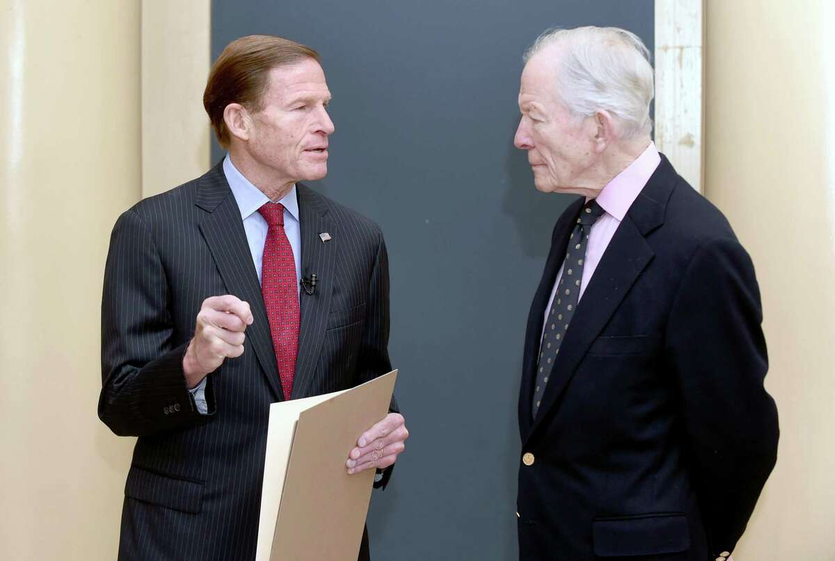U.S. Senator Richard Blumenthal, above and left, reads a resolution on Friday concerning a search for the San Antonio Rose B-17 Flying Fortress Heavy Bomber, pictured at left, that went down during World War II in the Pacific Ocean and remains missing at Woolsey Hall in New Haven . Above and at right is Doug Walker, son of Brigadier General Kenneth N. Walker, whose father was part of the crew of 11 aboard the plane.