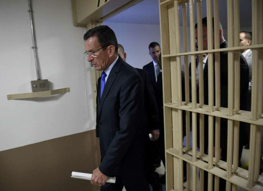 During thre summer of 2015, Gov. Dannel Malloy toured the Hartford Correctional Center and met with inmates to discuss his recently-passed Second Chance Society initiatives aimed at helping inmates bck into their communities and reduce repeat offenders. The state prison population on Friday reached a historic low. Photo: John Woike / Hartford Courant / Connecticut Post contributed