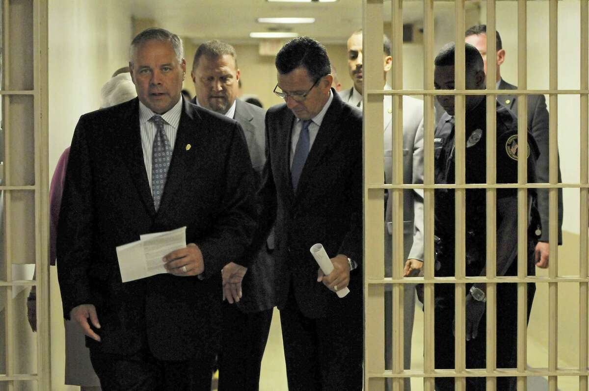 Corrections Commissioner Scott Semple led Gov. Dannel Malloy on a tour of the Hartford Correctional Center in July, 2015. Semple and Malloy recently announced that falling inmate populations will lead to the closure next year of of the Enfield Correctional Institution, a medium-security facility.