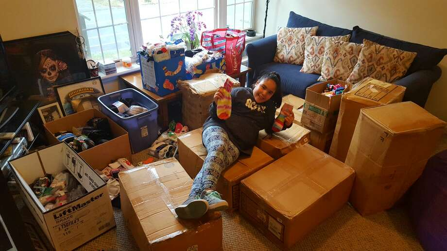 "Eleven-year-old Seymour Middle School student Adelina ""Lulu"" Barreira collected 4,147 pairs of socks to donate to local charities through her project, ""Lulu's Socktober Fest."" Photo: Contributed"