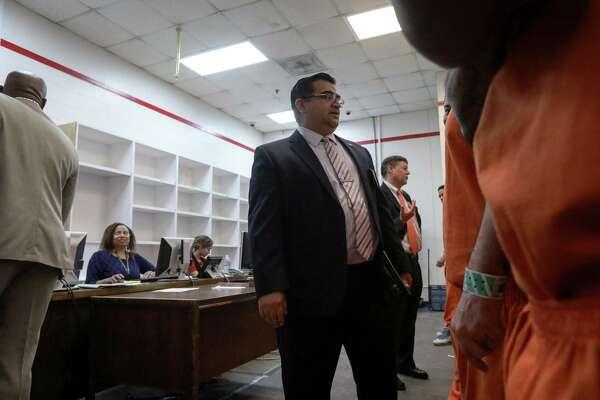Prosecutors, attorneys cut 'Harvey deals' in jail basement