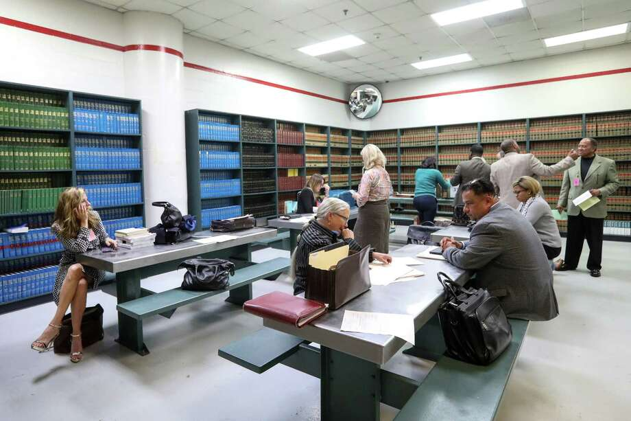 "Attorneys work in a room called the ""law library,"" in the Harris County Jail, Friday, Oct. 27, 2017, in Houston. Temporary courts were setup in the jail because Hurricane Harvey damaged the Harris County Criminal Courthouse. Photo: Jon Shapley, Houston Chronicle / © 2017 Houston Chronicle"