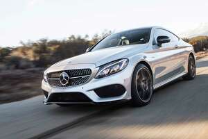 The coupe's AMG 4MATIC all-wheel-drive has a 31:69 front/rear torque split.