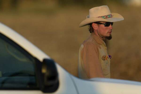 Johnnie  Langendorff, who pursued the suspect of the Sutherland Springs First Baptist Church shooting, waits Sunday, Nov. 5, 2017, to be picked  up from the scene where the gunman died near the intersection of FM 539  and Sandy Elm Road in Guadalupe County.