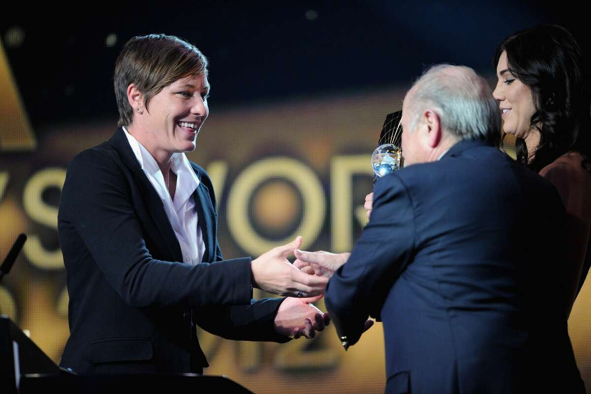 Abby Wambach of the USA receives the FIFA Women's World Player of the Year award from US teammate Hope Solo and FIFA President Joseph S. Blatter during the FIFA Ballon d'Or Gala 2012 at the Kongresshaus on January 7, 2013 in Zurich, Switzerland. (Photo by Stuart Franklin - FIFA/FIFA via Getty Images)