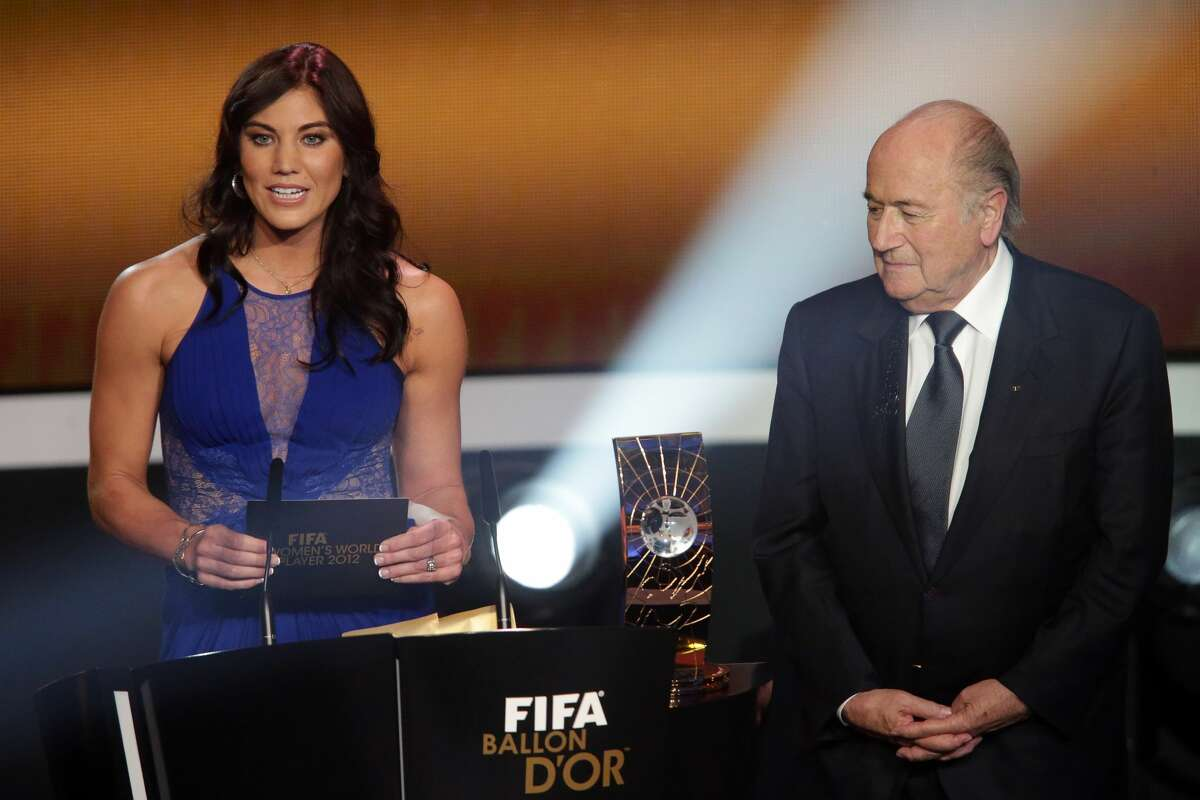 Hope Solo and Joseph Blatter, FIFA president announce Abby Wambach of United States during the FIFA womens player of the year trophy during the FIFA Ballon d'Or Gala 2013 at Congress House on January 07, 2013 in Zurich, Switzerland. (Photo by Christof Koepsel/Getty Images)
