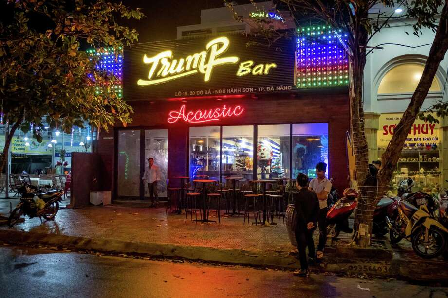 """The 5-month old bar named after U.S. President Donald Trump is seen on November 9, 2017 in Danang, Vietnam. Nguyen Ha Anh Tuan, 32 - owner of Trump Bar, states that he likes Trump's turbulence and he wants to bring that spirit to his bar. According to Tuan, naming his bar after the U.S President is """"an wise marketing move"""". U.S. President Donald Trump, who is on a 12-day Asia trip, will take part in the Asia-Pacific Economic Cooperation summit hosted by Vietnam this year. The APEC leaders meeting, which opens on Friday in Danang, Vietnam, aims to promote free trade throughout the Asia-Pacific region. Photo: Linh Pham /Getty Images / 2017 Getty Images"""