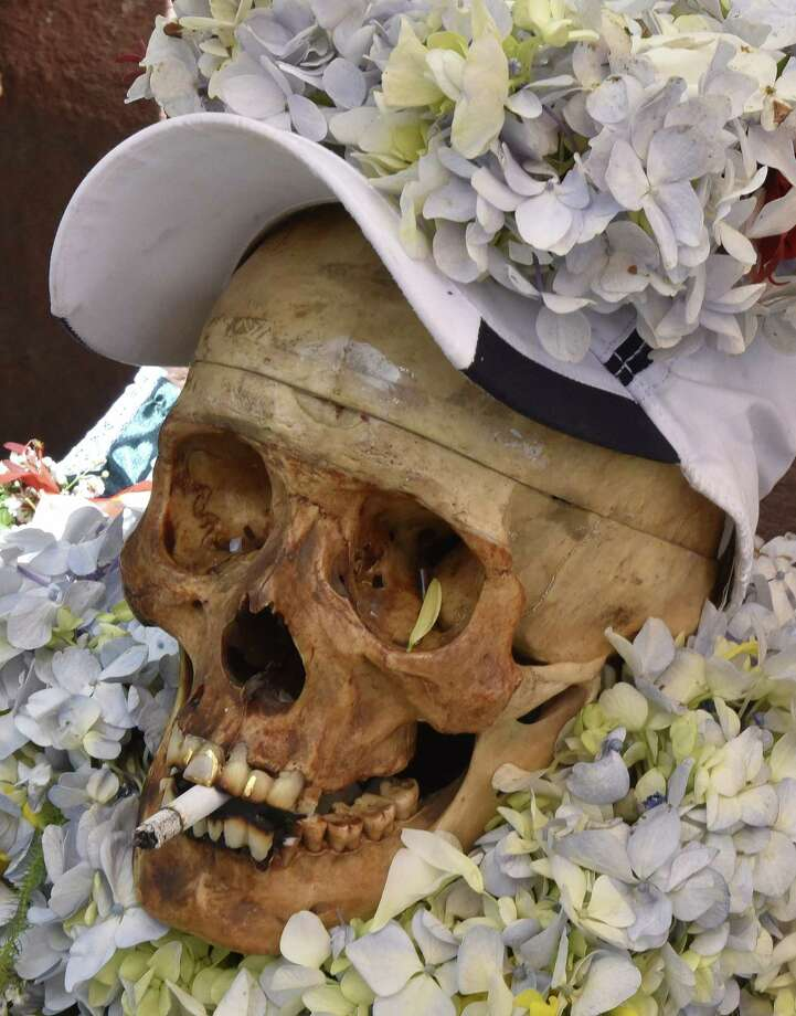 "Picture of a ""natita"" (snub-nosed) human skull taken at the Central Cemetery of La Paz during the annual traditional ritual on November 8, 2017. The ""natitas"" are meant to protect their owners, who keep them at home all year long and bring them to the cemetery chapels every November 8 to perform rituals which end up in a traditional party. / AFP PHOTO / Aizar RALDESAIZAR RALDES/AFP/Getty Images Photo: AIZAR RALDES, AFP/Getty Images / AFP or licensors"