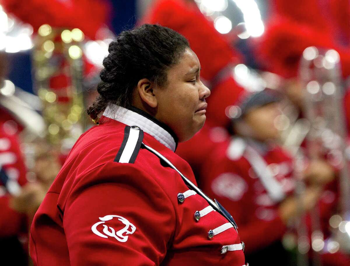 A members of the Crosby High School band reacts after performing during the UIL Marching Band State Championships at the Alamodome, Wednesday, Nov. 8, 2017, in San Antonio.