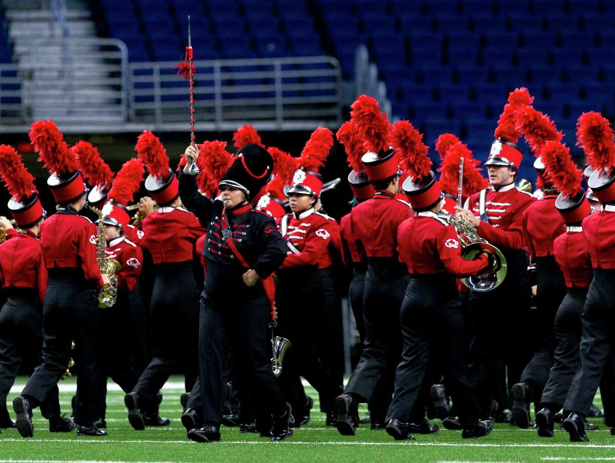 Drump Major Darian Aulds leads the Crosby High School band as they perform during the UIL Marching Band State Championships at the Alamodome, Wednesday, Nov. 8, 2017, in San Antonio.