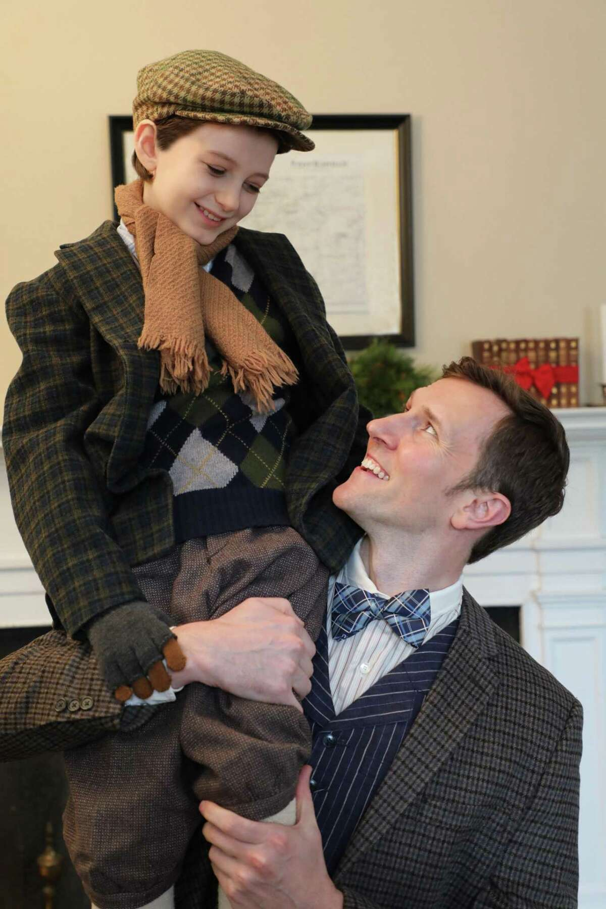 """Connecticut native Robert Berson (Tiny Tim), left, with Matt Gibson (Bob Cratchit), in a scene from """"A Connecticut Christmas Carol,"""" presented by Goodspeed Musicals, Nov. 17 through Dec. 24 at the Terris Theatre in Chester."""