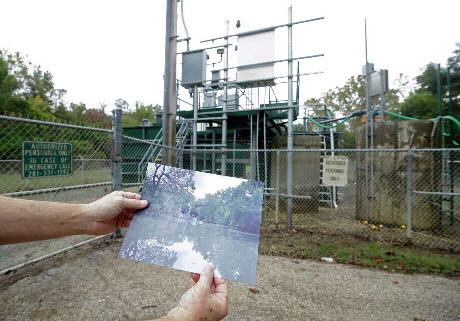 Steve Dorman, superintendent, displays a photo of the damaged sewage treatment plant at the Bear Creek Pioneers Park, 3535 War Memorial Drive, that was flooded during Hurricane Harvey Wednesday, Nov. 1, 2017, in Houston. Photo: Melissa Phillip, Houston Chronicle / © 2017 Houston Chronicle