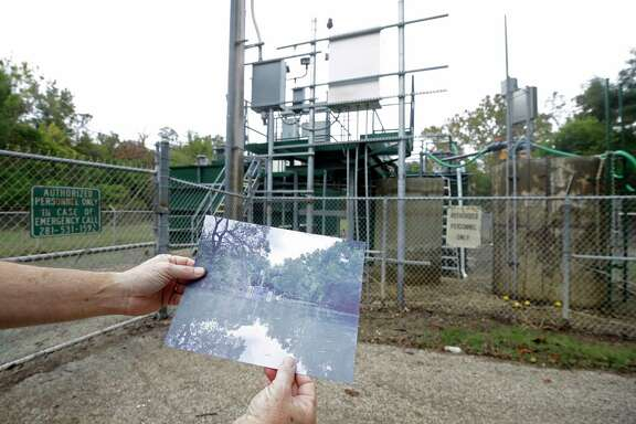 Steve Dorman, superintendent, displays a photo of the damaged sewage treatment plant at the Bear Creek Pioneers Park, 3535 War Memorial Drive, that was flooded during Hurricane Harvey Wednesday, Nov. 1, 2017, in Houston.