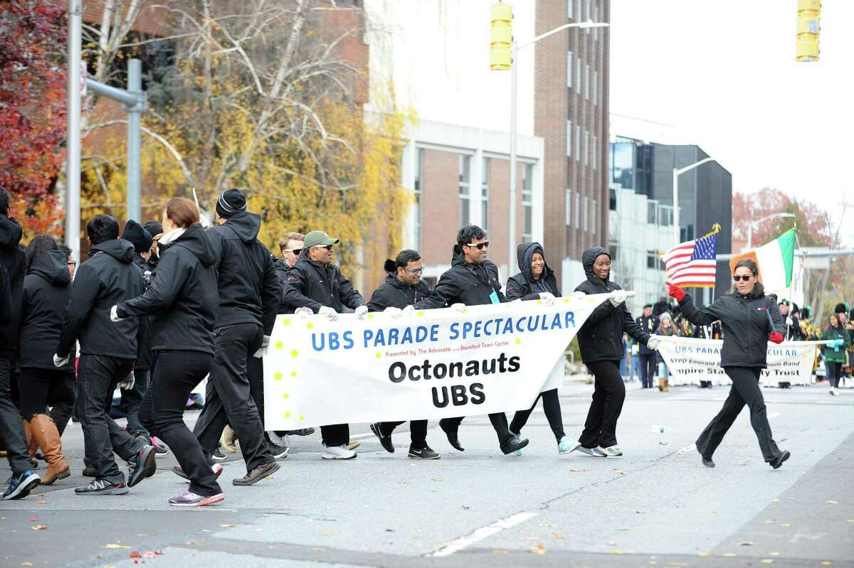 Parade Must Go On: Volunteers tasked with holding the new Octonauts balloon spin for the crowd, even though their balloon had been grounded, during last year's UBS Parade Spectacular in downtown Stamford.
