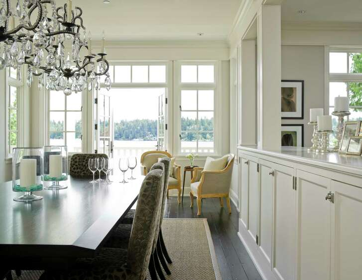 The dining room in this Mercer Island home is filled with antiques.