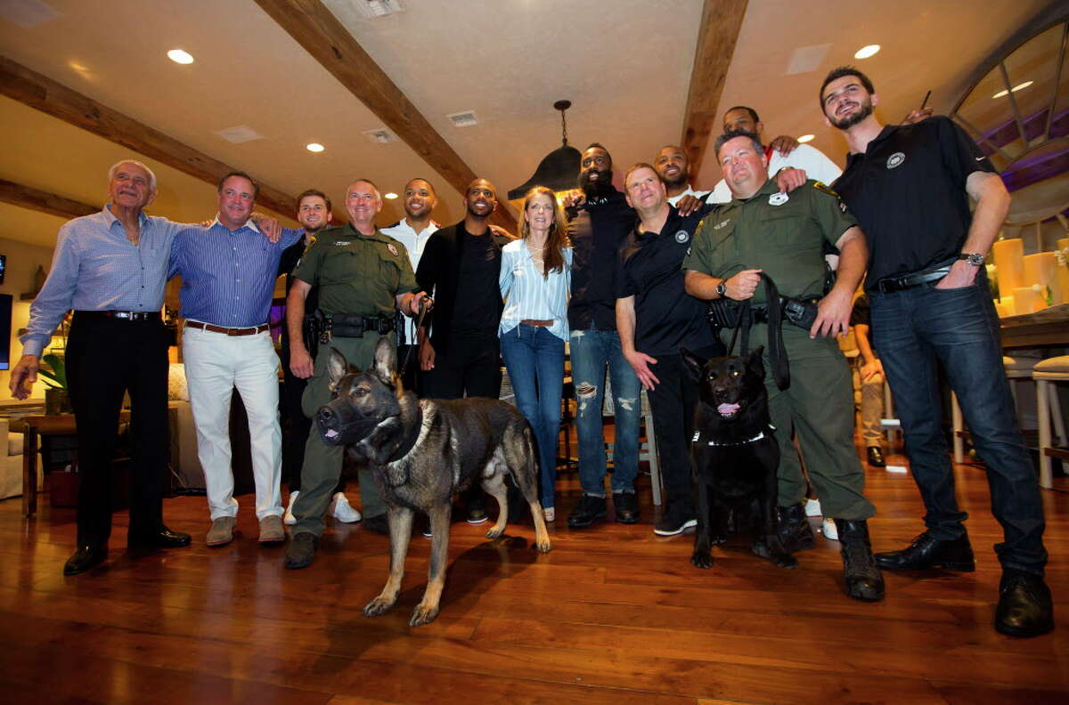 """Members of the Rockets organization and HPD join the Fertitta family at the Houston Police Foundation Board of Director's """"True Blue"""" Gala on Saturday, Nov. 4, 2013, in River Oaks. (Annie Mulligan / Freelance)"""