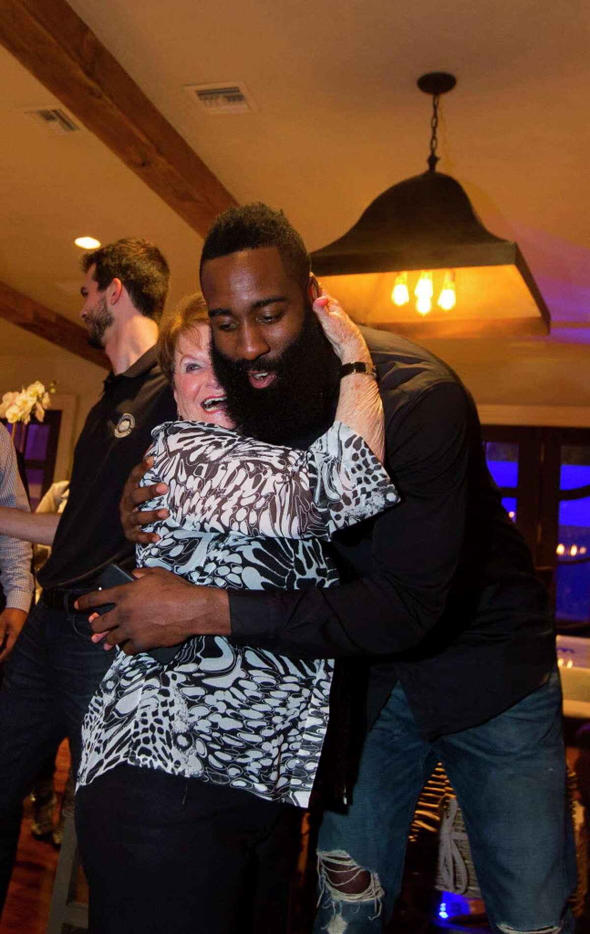 "Joy Fertitta gets a hug from James Harden at the Houston Police Foundation Board of Director's ""True Blue"" Gala on Saturday, Nov. 4, 2013, in River Oaks. (Annie Mulligan / Freelance)"