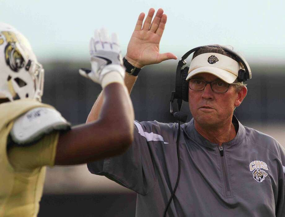 Conroe head coach Robert Walker gives a high-five to tailback Donaven Lloyd after scoring a two-yard touchdown during the first quarter of a non-district game Thursday at Buddy Moorhead Stadium in Conroe. Photo: Jason Fochtman / Jason Fochtman