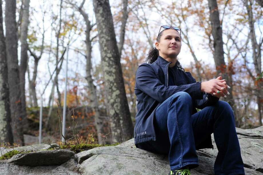 """Raven Matherne, Stamford's first transgender city rep, poses for a photo on a large boulder next to her house in north Stamford, Conn. on Thursday, Nov. 9, 2017. Matherne climbed the boulder as a kid, saying, """"it was the first mountain I ever climbed."""" Photo: Michael Cummo / Hearst Connecticut Media / Stamford Advocate"""