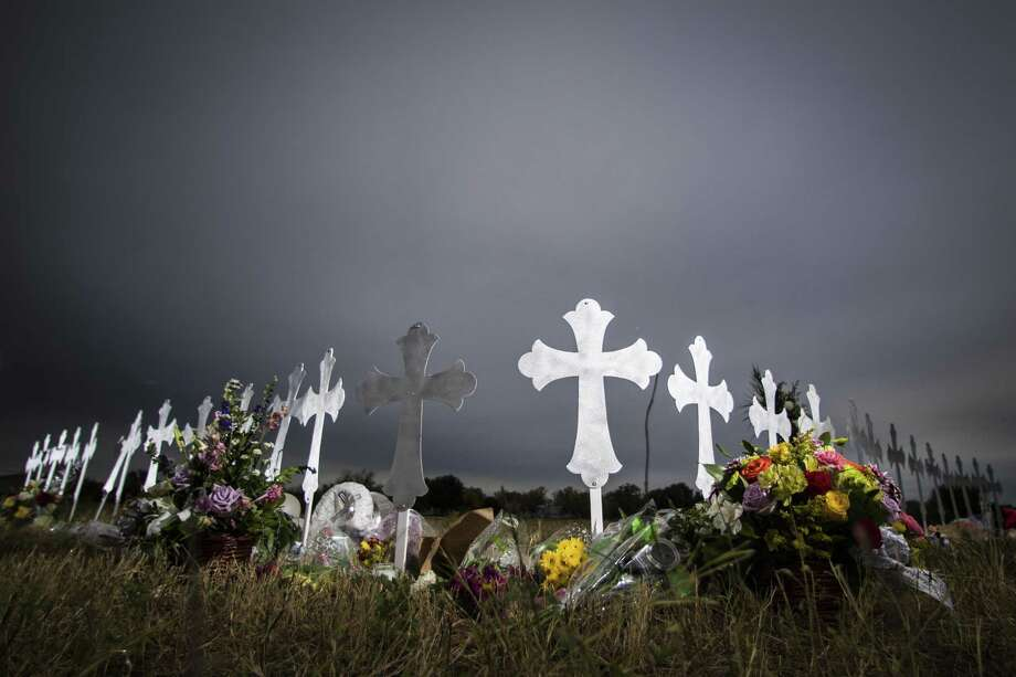 Twenty-six crosses have been placed near a ball park in Sutherland Springs, representing the 26 lives lost during a shooting in the First Baptist Church. A reader wonders how the shooter was able to pass backgrounds checks when he purchased the weapons. Photo: Marie D. De Jesus /Houston Chronicle / © 2017 Houston Chronicle