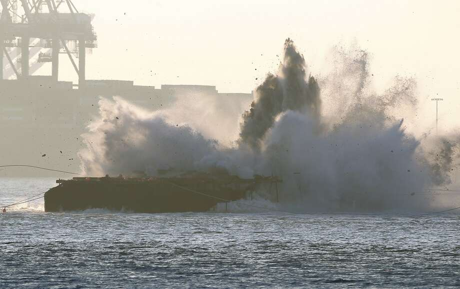 A demolition team will demolish the last two piers of the old Bay Bridge near the east side of the new span early Saturday, Nov. 11, 2017. This file photo shows old an implosion of an old bridge pier on Nov. 14, 2015. Photo: Paul Chinn, The Chronicle