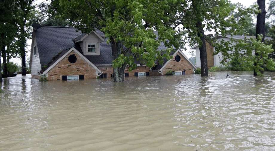 In Texas, 150,000 homes were lost during Hurricane Harvey. Here, a home is surrounded by floodwaters from the storm in Spring. Homeowners embarking on rebuilding should follow some tips. Photo: David J. Phillip /Associated Press / Copyright 2017 The Associated Press. All rights reserved.