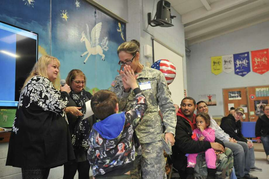 Students and faculty at the Batcheller Early Education Center in Winsted celebrated veterans Friday afternoon. Photo: Ben Lambert / Hearst Connecticut Media